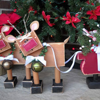 Whimsical wooden reindeers and a sleigh with simple shapes