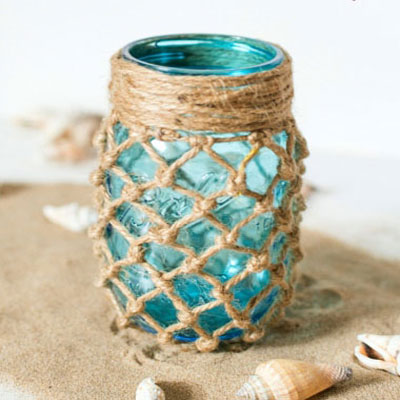 Fishnet wrappet wason jar lanterns