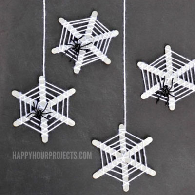 Popsicle stick spider webs with yarn - Halloween craft for kids
