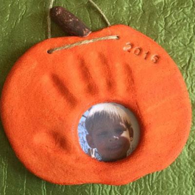 Pumpkin handprint and photo keepsake with salt dough