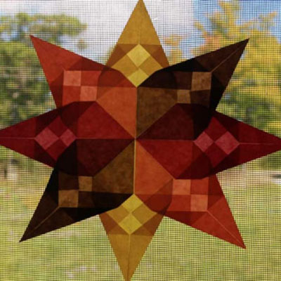Fall window paper stars - easy autumn decors with origami