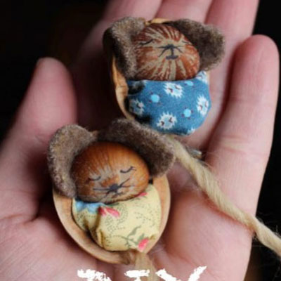 Adorable hazelnut mice in walnut cradles