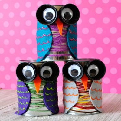 Colorful tin can owls with plastic cup eyes