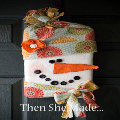 Adorable fabric no-sew snowman from a cardboard box
