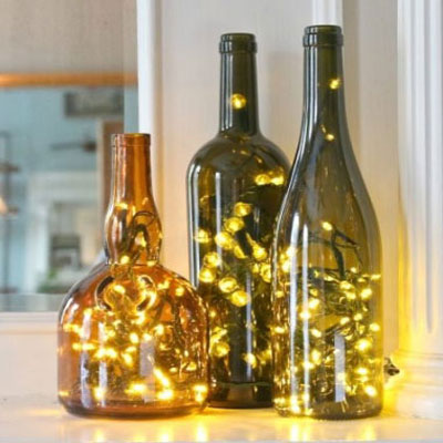 How to put Christmas lights in empty glass (wine) bottles