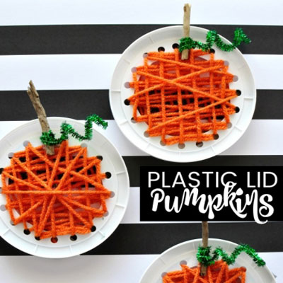 Fall pumpkin yarn sewing craft for kids from plastic lids