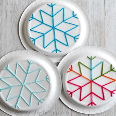 Easy paper plate snowflake yarn art for kids