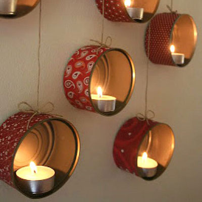 Wall tea candle holder from tin cans