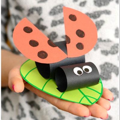 DIY Construction paper ladybug on a leaf - spring craft for kids