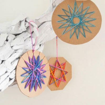 Cardboard christmas tree ornaments with yarn