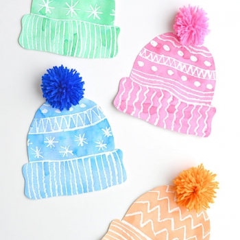 Winter hat art project for kids with DIY pom poms