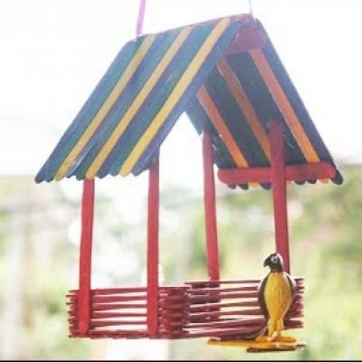 DIY Craft stick bird feeder -  popsickle stick craft for kids