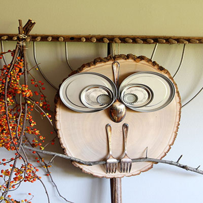 DIY wood slice owl with spoons forks and lids