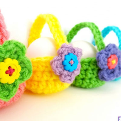 Little crocheted egg baskets with flower