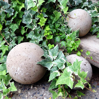 DIY concrete garden globes (with old glass lamp globes)